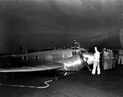 574x450xAmelia-Earharts-Lockheed-Electra-10E-NR16020-crashed-on-takeoff-at-NAS-Ford-Island-Pea...jpg