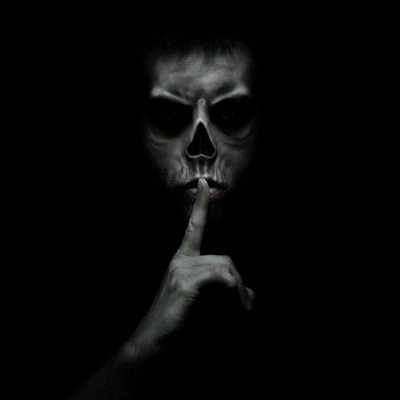 33822336-evil-man-gesturing-silence-quiet-isolated-on-black-background.jpg