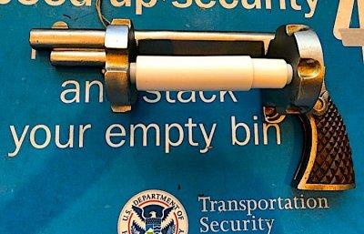 gun-toilet-roller.jpeg